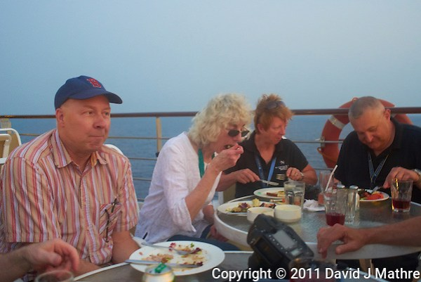 Jon, Joan, Liz, and Joe Eating Dinner on Deck 6 of the M/V Explorer. Image taken with a Leica X1 (ISO 1000, 24 mm, f/2.8, 1/30 sec). Raw image processed with Capture One Pro 6, Topaz DeNoise 5 - Strong RAW, and converted to JPG/sRGB with Photoshop CS5. (David J Mathre)