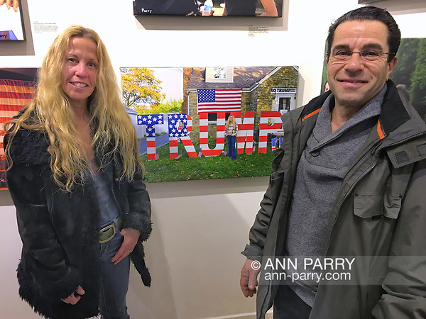 "Huntington, New York, USA. March 5, 2017. Eileen Fuscaldo and her husband, next to 2016 photo of Eileen, at Opening Reception for ""Her Story Through Art"" Invitational Art Show, celebrating Women's History Month, at Huntington Arts Council, Main Street Gallery. Artists Tara Leale Porter, Irene Vitale, Anahi DeCanio, Ann Parry, Show March 2 - 25, 2017. (Ann Parry/Ann Parry, ann-parry.com)"