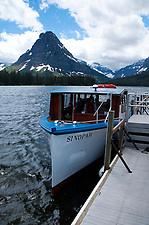 Sinopah Tour Boat Under Sinopah Peak on Two Medicine Lake, Glacier National Park, Montana, US (Roddy Scheer)