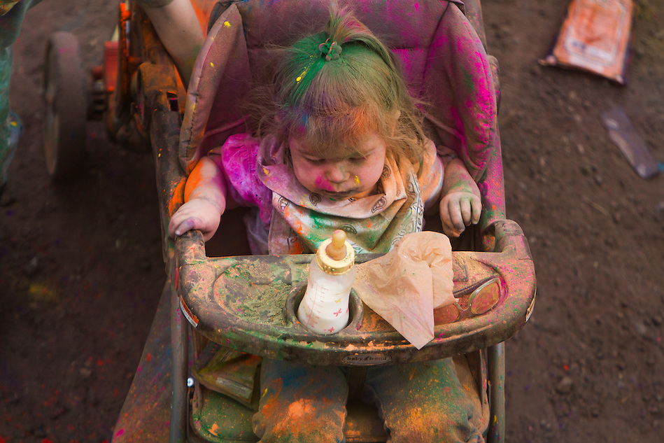 The Holi Festival of Colors, at the Lotus Temple, in Spanish Fork Utah, is a family festival which many parents bring their children to even considering the array of  thick color filling the air, on Saturday, Mar. 24, 2012. (Photo by Benjamin B. Morris ©2012) (Benjamin B. Morris)