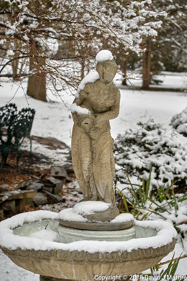 Birdbath statue with snow in April -- Winter is not gone. Image taken with a Leica TL2 camera and 60 mm f/2.8 lens (ISO 100, 60 mm, f/4.5, 1/200 sec). (David J Mathre)