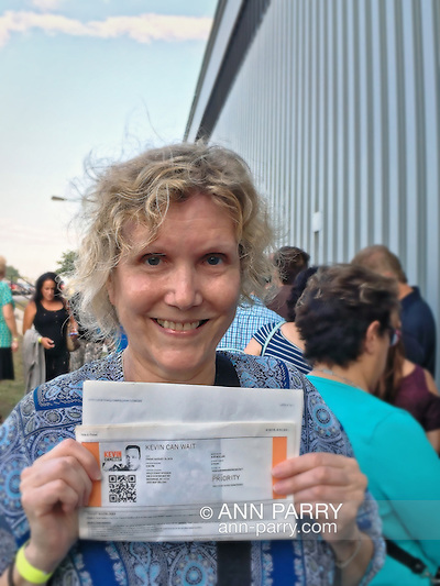 Bethpage, New York, USA. August 19, 2016. Ann holds printed sheet with PRIORITY TICKETS to be in audience during taping of CBS new comedy series