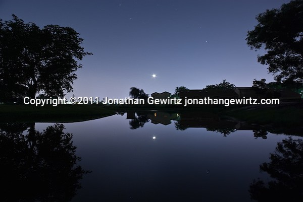 Houses along a golf-course pond at night, Davie, Florida. (Jonathan Gewirtz)