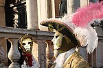 Man looking into mirror dressed in traditional mask and costume for Venice Carnival standing in Piazza San Marco, Venice, Veneto, Italy (Brad Mitchell Photography)