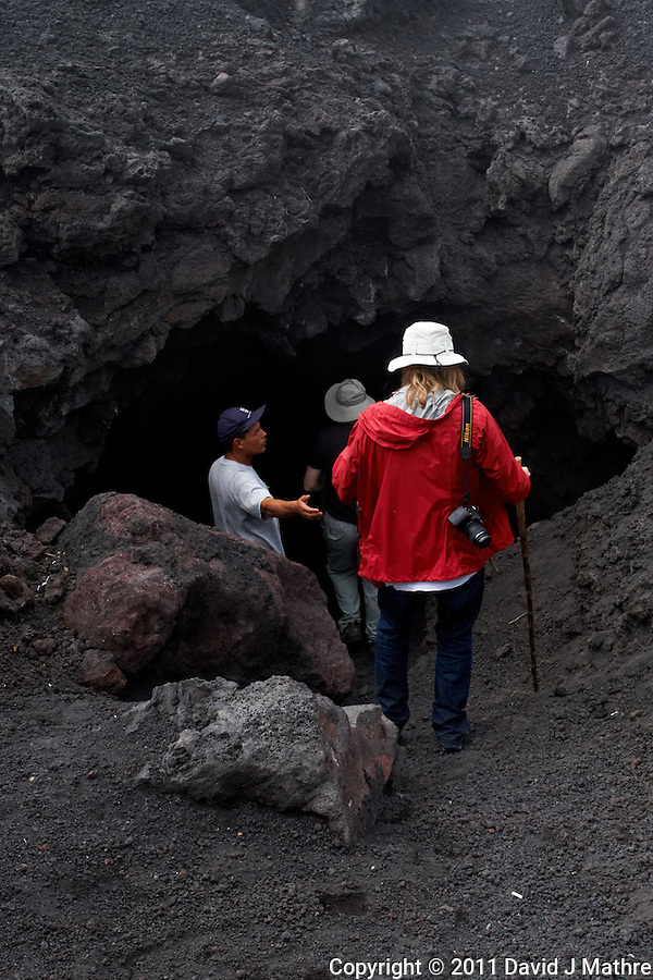 Jenny entering a tunnel in the Volcano. Pacaya Volcano National Park. Image taken with a Nikon D3x and 24 mm f/1.4G lens (ISO 450, 24 mm, f/8, 1/320 sec). Raw image processed with Capture One Pro and Photoshop CS5. (David J Mathre)