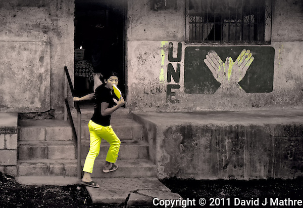 Girl with Yellow Pants Running into Building with UNE Party Sign in San Francisco de Sales. Pacaya Volcano National Park. Image taken with a Nikon D3x and 24 mm f/1.4G lens (ISO 280, 24 mm, f/2.8, 1/200 sec). Raw image processed with Capture One Pro, Nik Viveza 2, Nik Define 2 and Photoshop CS5. (David J Mathre)