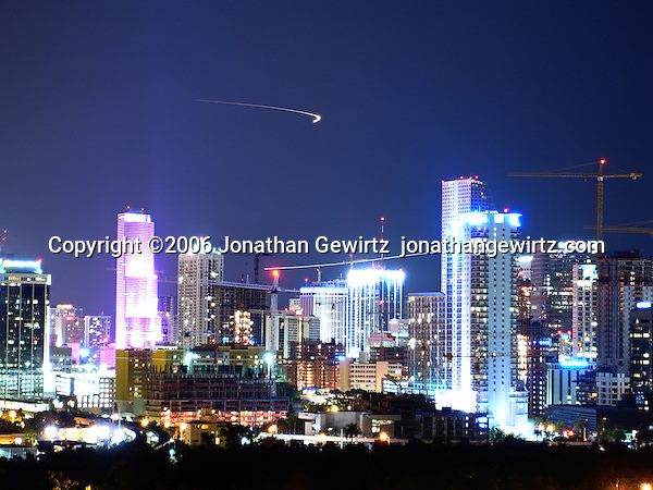 Night view of commercial and residential buildings and building construction in downtown Miami during the tail end of the real estate boom, October 2006. (Jonathan Gewirtz)