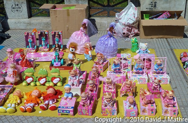 Dolls for sale on the street along Laguna de los Coipos in Buenos Aries. Images taken with a Leica V-Lux 20 camera (ISO 80, 11.9 mm, f/5.6, 1/400 sec) (David J Mathre)