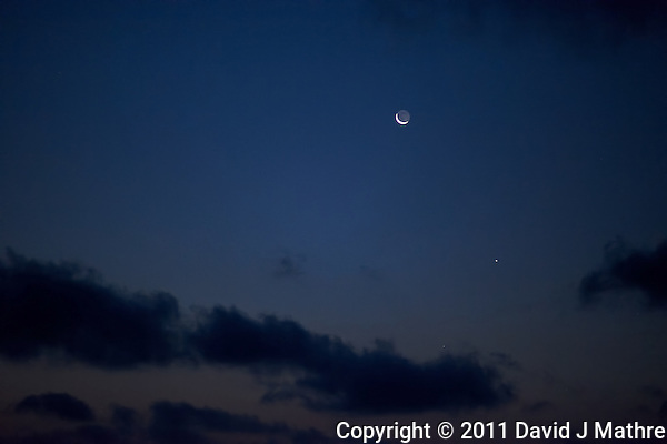 Pre-Dawn View of the Moon, Venus, and Mercury. Image taken with a Nikon D3x and 85 mm f/1.4G (ISO 1600, 85 mm, f/1.4, 1/30 sec). Raw image processed with Capture One Pro 6 and converted to jpg/sRGB with Photoshop CS5. Noise Reduction with Topaz DeNoise 5.0. (David J Mathre)