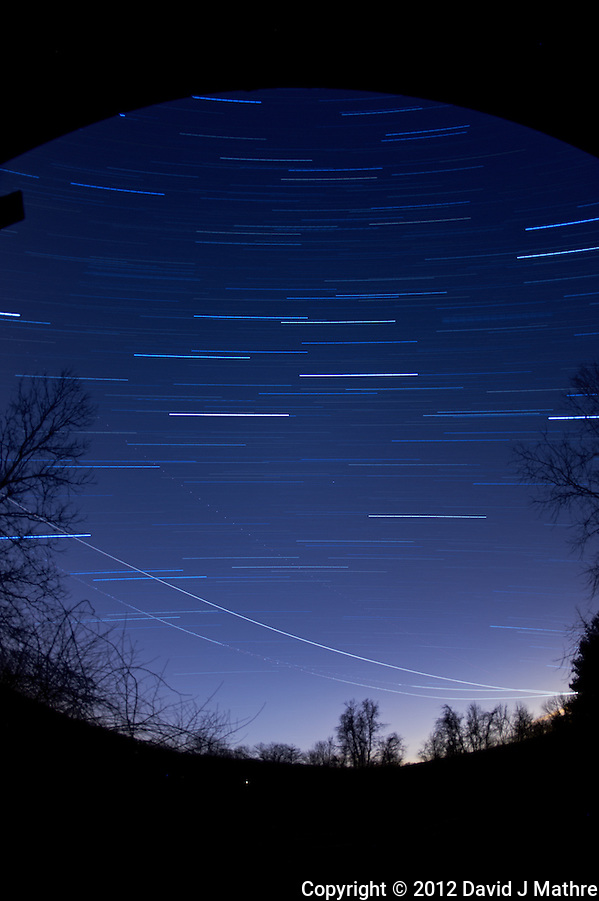 Winter Sky Star and Jet Trails. Image taken with a Nikon D700 and 16 mm f/2.8 fisheye lens (ISO 200, f/2.8, 300 sec). Composite of 14 images processed with Startrails program. (David J. Mathre)