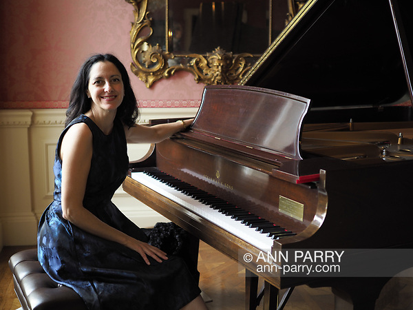 Old Westbury, New York, USA. December 17, 2017. Pianist ANGELINA FUSCO plays Christmas music on Steinway grand piano to entertain visitors at Old Westbury Gardens museum, a former estate of John Shaffer Phipps, during snowy winter holiday weekend on Long Island's Gold Coast. (© 2017 Ann Parry/Ann-Parry.com)