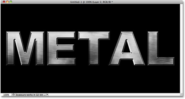 The metal text effect after applying the Clouds filter. Image © 2010 Photoshop Essentials.com.
