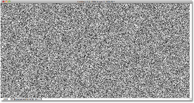 The Photoshop document filled with noise. Image © 2010 Photoshop Essentials.com.
