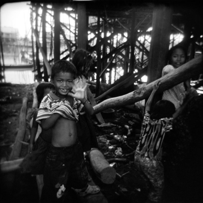 Boy waving, Kompong Khleang, Cambodia | Holga 120N | Kodak Tri-X 400
