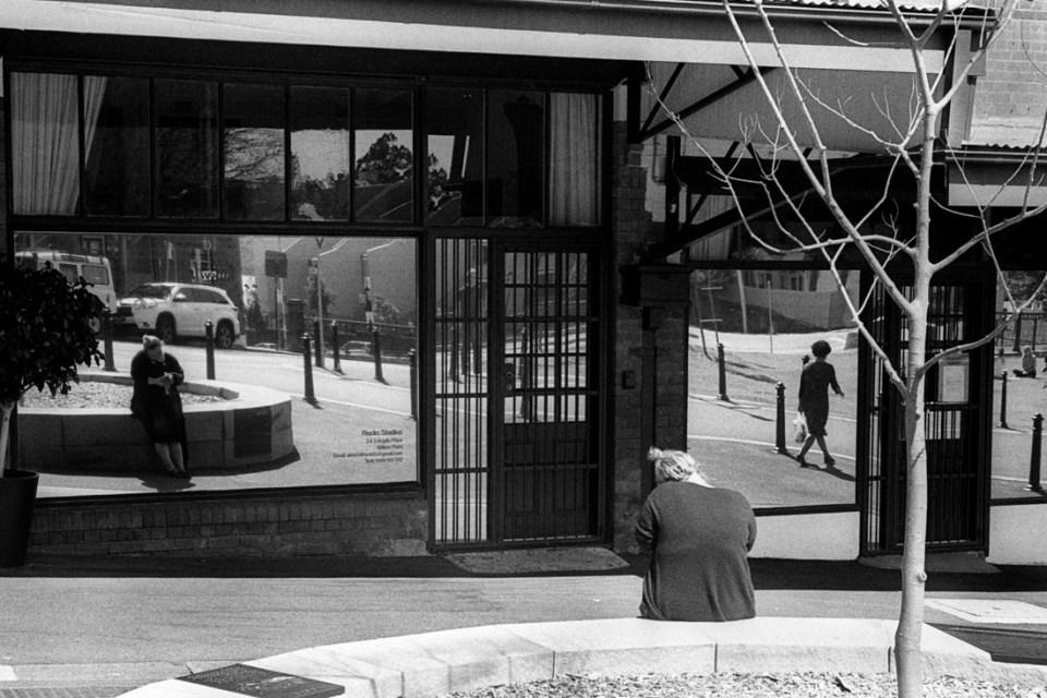 Reflective street | Leica M3 | Leitz Summicron 5cm f/2 DR | Ilford HP5 Plus