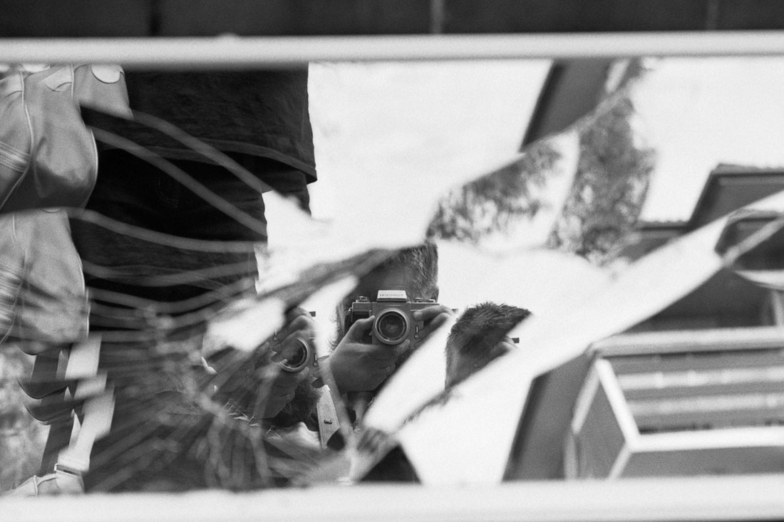 Shattered mirror selfie | Topcon RE Super | Topcor 10cm f/2.8 RE Auto | JCH Street Pan 400