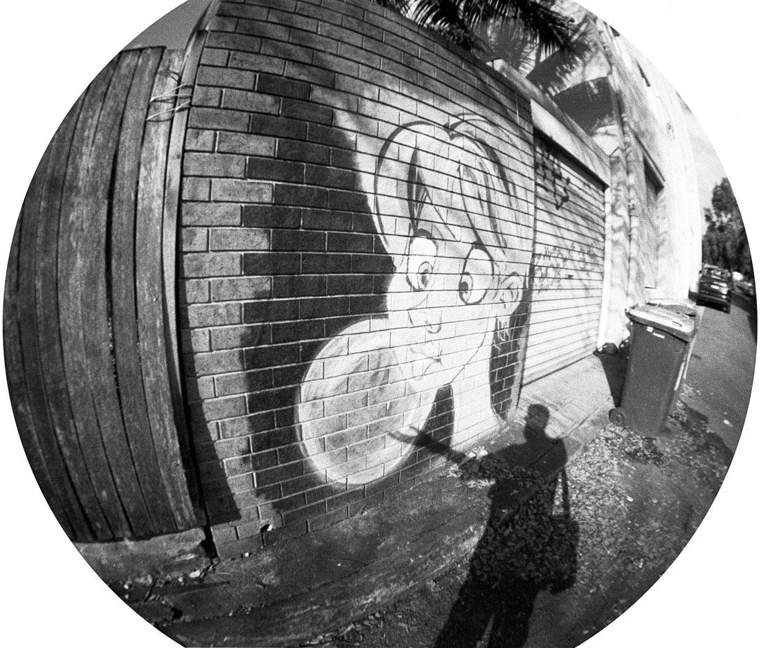 Holding up the bubble | Lomography Fisheye 2 | Ilford HP5 Plus
