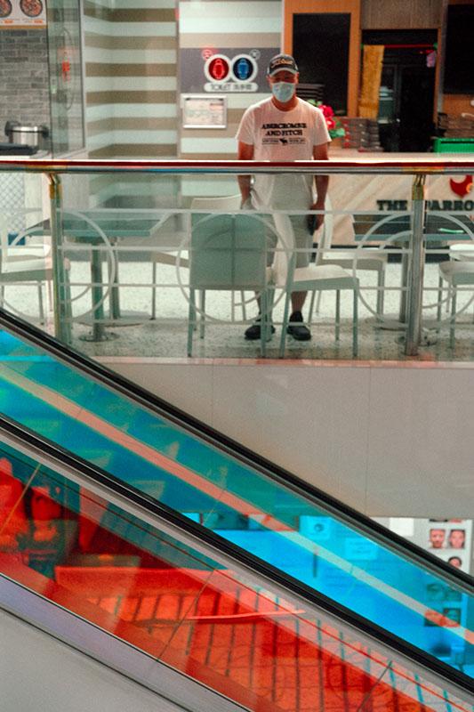 Staring over the escalator | Leica M2 | Leica Summicron 5cm f/2 | Fujifilm Press 800