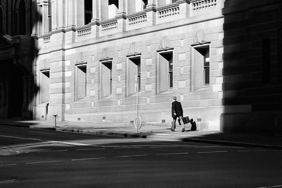 Busy in empty city | Nikon F100 | Nikkor 85mm 1:2 Ai-S | Kodak Double X