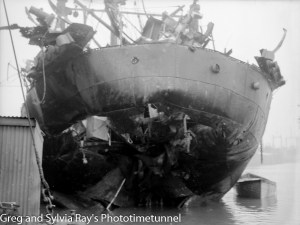 The torpedo-damaged ship Allara in Newcastle Harbour, July 1942. (13)