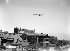 Boeing Superfortress bomber flying over Newcastle Cathedral and Newcastle Club.