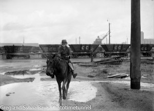 A boy on a horse near the Newcastle waterfront on a wet day, May 20, 1940.