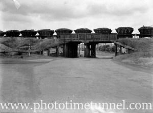 Coal wagons on the overhead bridge at Howe Street, Lambton, November 14, 1940.