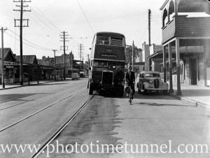 Bus and cyclist on Maitland Road, Islington, Newcastle, NSW, November 22, 1940.