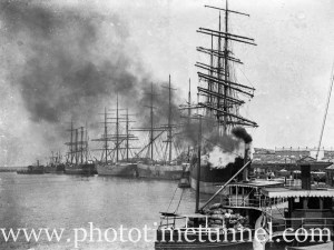 Sailing ships seen through a cloud of smoke from a steam boat on Newcastle Harbour, NSW, circa 1910.