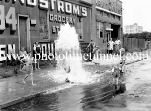 A broken water main on the corner of King and Darby Streets, Newcastle, NSW, January 26, 1945.