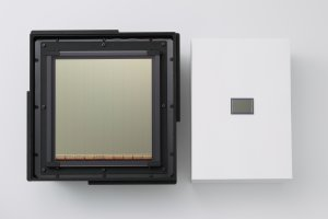 The ultra-large-scale, ultra-high-sensitivity CMOS sensor (left) alongside a 35 mm full-frame CMOS sensor