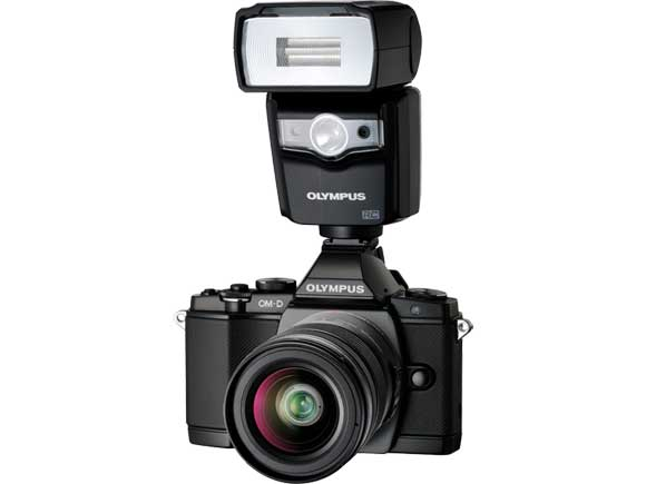 Olympus OM-D E-M5 with external flash FL-600R attached