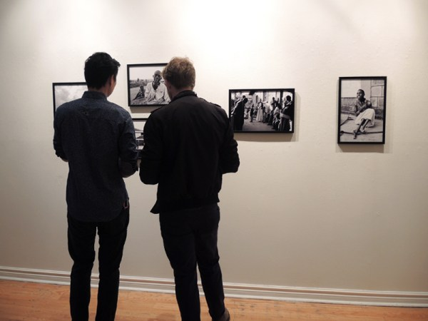 Visitors at the opening of SHERP: Long Wanderings in Northern Kenya, by Jordan Campbell, at the Alliance Française Gallery, a CONTACT 2014 Featured Exhibition.