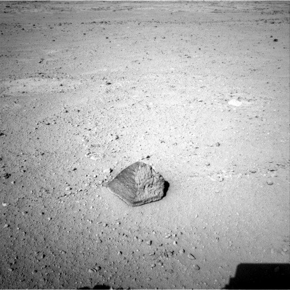"""The drive by NASA's Mars rover Curiosity during the mission's 43rd Martian day, or sol, (Sept. 19, 2012) ended with this rock about 8 feet (2.5 meters) in front of the rover. The pyramid-shaped rock is about 10 inches (25 centimeters) tall and 16 inches (40 centimeters) wide. The image was taken by the left Navigation camera (Navcam) at the end of the drive. The rock has been named """"Jake Matijevic."""" Image Credit: NASA/JPL-Caltech."""