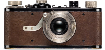 The refined and improved version of Barnack's camera went into serial production under the name of Leica (Leitz Camera) and was presented to the public in March 1925, at the Leipzig Spring Fair. It was fitted with a non-interchangeable, Leitz Anastigmat 50 mm f/3.5 lens designed by Max Berek in a collapsible mount. Soon afterwards, the lens was given the name Elmax (Ernst Leitz, Max Berek). In the same year, Berek employed a new glass type in his design for the Elmar 50 mm f/3.5 – a lens that was to become as world famous as the Leica itself.'