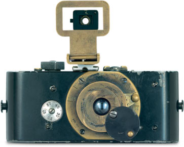 """Oskar Barnack invents the Ur-Leica. """"The construction of the first, fully functional prototype of a revolutionary new still picture camera for 35 mm perforated film was completed by Oskar Barnack in March 1914. The camera had a full metal body, a collapsible lens and a focal plane shutter, which, at the time, had no overlapping curtains. A cap, fixed to the lens by a screw, was swung across the lens when winding on the film to prevent light getting in. The Ur-Leica was the first camera to feature coupled film winding and shutter cocking – thus preventing double exposures."""""""