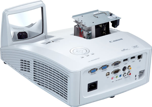 Canon Ultra-short Throw Multimedia Projector LV-WX300UST; front and side. Lamp apparatus is located above the Canon name.