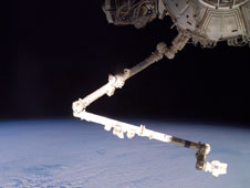 The Expedition 11 crew aboard the International Space Station flexes the robotic arm, Canadarm2, while flying approximately 225 miles above Cape Horn. Image Credit: NASA.