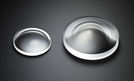 """To offer an ultra-wide-angle 20mm focal length and F1.4 brightness at wide-open aperture, this lens incorporates a large double aspherical lens 59mm in diameter."" Left side: The aspherical glass element incorporated in the SIGMA 18-35mm F1.8 DC HSM 