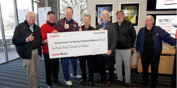 Canon U.S.A. presents John Walsh with a check for $390,400 : Image Courtesy of Canon