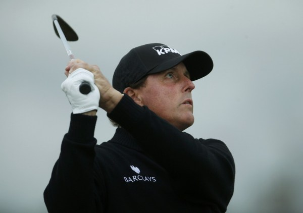 Mickelson of the U.S. watches his shot on the second hole during a practice round ahead of the British Open golf championship on the Old Course in St. Andrews, Scotland