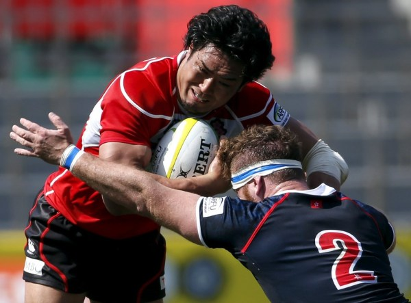 Japan's Ito is tackled by Hong Kong's Harris during their international rugby test match in Tokyo