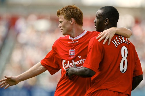 LIVERPOOL'S HESKEY AND RIISE CELEBRATE AFTER SCORING IN HONG KONG.