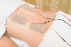 TENs therapy Electrodes of tens device on back muscle