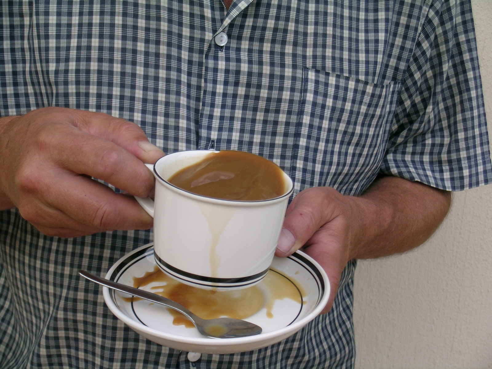 Person with Parkinson's disease spilling coffee from shaking. Motor function, hand, coffee, man.