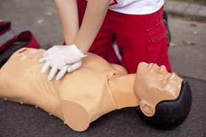 Cardiopulmonary resuscitation (CPR) medical procedure - Demonstrating chest compression on CPR doll