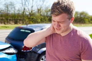 Driver Suffering From Whiplash After Traffic Collision