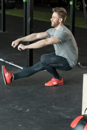 Man doing one leg squat at the gym ** Note: Soft Focus at 100%, best at smaller sizes