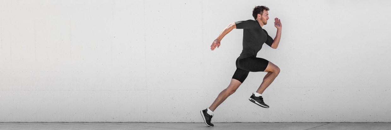 Running man runner training doing outdoor city run sprinting alo