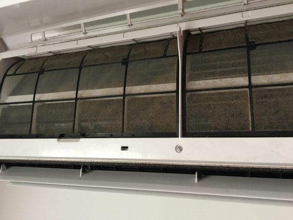 Dirty split system aircon filter ready for servicing